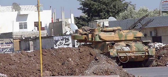 Caption: A Syrian armoured vehicle is seen at Hula town near Homs September 30, 2011. REUTERS/Handout (SYRIA - Tags: POLITICS CIVIL UNREST MILITARY) THIS IMAGE HAS BEEN SUPPLIED BY A THIRD PARTY. IT IS DISTRIBUTED, EXACTLY AS RECEIVED BY REUTERS, AS A SERVICE TO CLIENTS