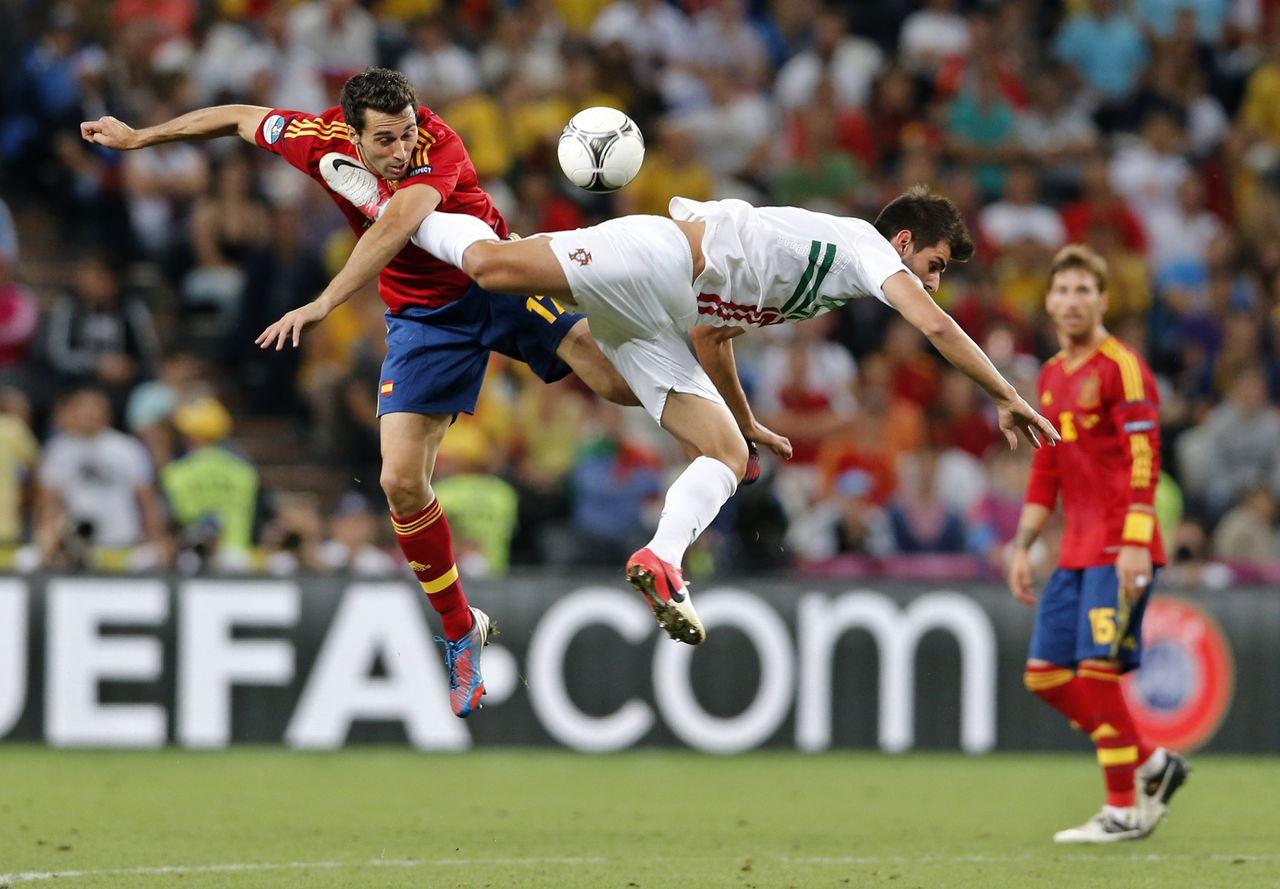Spain's Alvaro Arbeloa left, and Portugal's Nelson Oliveira jump for the ball during the Euro 2012 soccer championship semifinal match between Spain and Portugal in Donetsk, Ukraine, Wednesday, June 27, 2012. (AP Photo/Antonio Calanni)