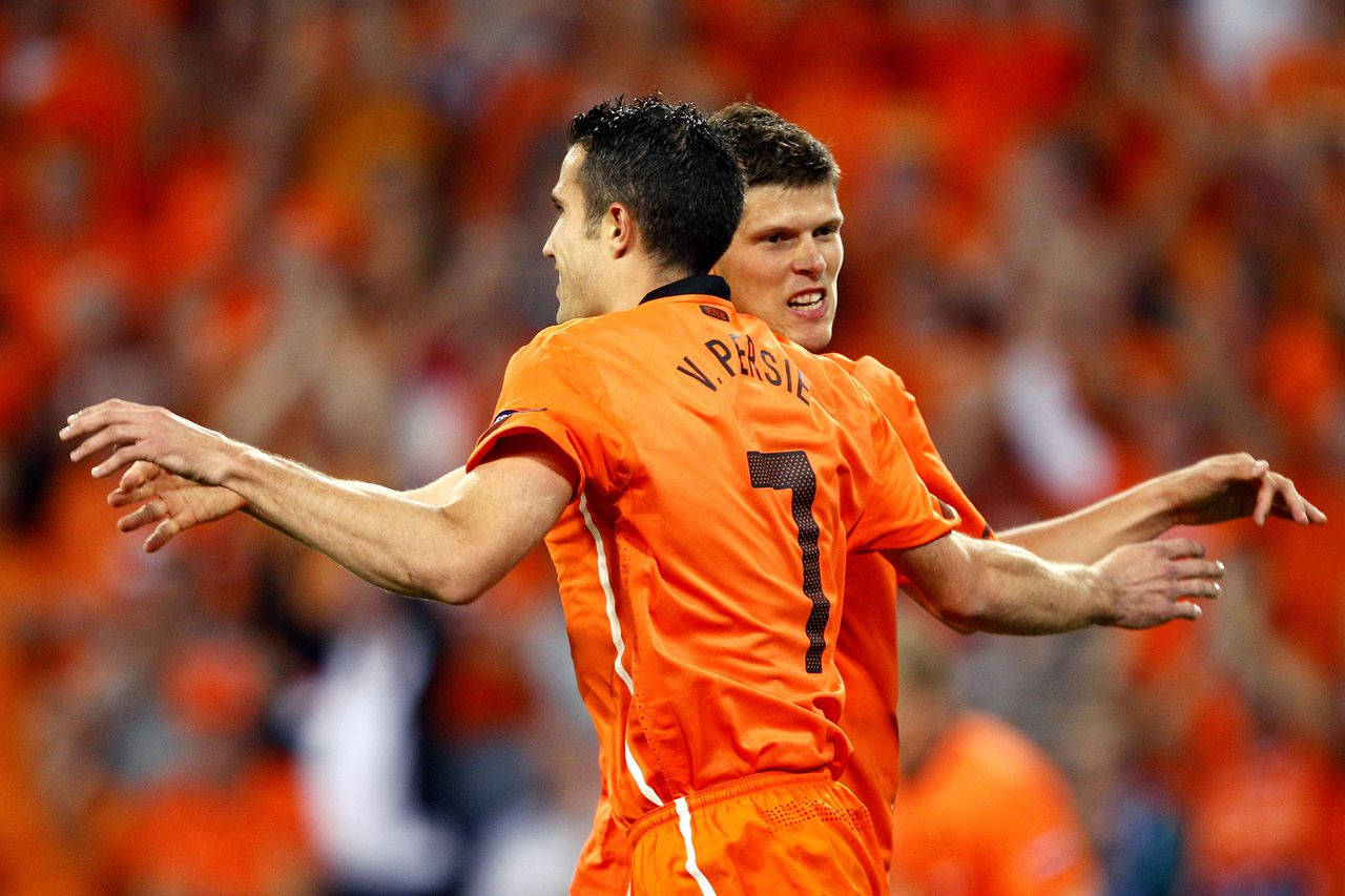 Dutch soccer player Robin van Persie, front, celebrates his goal against San Marino with Klaas Jan Huntelaar during the Euro 2012 Group E qualifying soccer match between The Netherlands and San Marino at the Philips stadium in Eindhoven, The Netherlands, friday Sept. 2, 2011. (AP Photo/Bas Czerwinski)