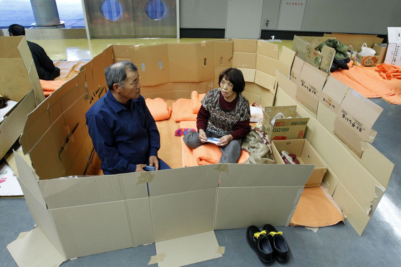 People who evacuated from Futaba, a city near the quake-stricken Fukushima Daiichi nuclear power plant, rest in a space cordoned off with cardboard in a hallway at the evacuees' new shelter Saitama Super Arena, near Tokyo March 20, 2011, nine days after an earthquake and tsunami hit Japan. About 2,300 people mainly from Futaba area arrived in Saitama, about 250 km (155 miles) away from their hometown, to evacuate after radiation leakage warnings. REUTERS/Jo Yong-Hak (JAPAN - Tags: DISASTER ENVIRONMENT SOCIETY IMAGES OF THE DAY)