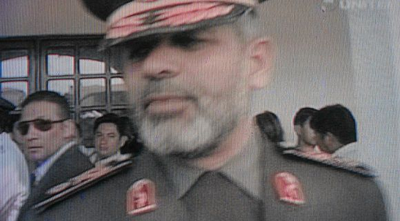 Iran's Defence Minister Ahmad Vahidi speaks to members of the media outside the Military Aviation headquarters in Santa Cruz in this still image taken of a video output by Unitel TV on May 31, 2011. Vahidi who was visiting Bolivia at the invitation of the Ministry of Defence was asked to leave the country on Tuesday after Argentina claimed he was involved in a 1994 attack on a Jewish center in Buenos Aires, according to the foreign ministry in Bolivia. REUTERS/Unitel TV via REUTERS/David Mercado (BOLIVIA - Tags: CIVIL UNREST MILITARY POLITICS) FOR EDITORIAL USE ONLY. NOT FOR SALE FOR MARKETING OR ADVERTISING CAMPAIGNS
