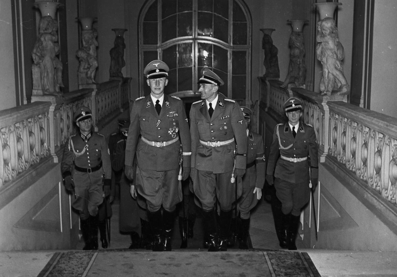 "More than 60 years ago, a group of Czech and Slovak exiles parachuted into their Nazi-occupied homeland and assassinated SS-Obergruppenfuehrer Reinhard Heydrich, the man known as the ""Butcher of Prague"".For the first time since the end of the World War Two, a German museum is offering a close look at ""Operation Anthropoid"", the code-name for the only successful assassination of a member of Hitler's inner circle. Undated file photo shows SS-Obergruppenfuehrer Reinhard Heydrich's climbing the stairs inside Prague's Hradcany castle. TO ACCOMPANY FEATURE GERMANY-CZECH-NAZI (EDITORIAL USE ONLY) ( NO ARCHIVE) ( NO THIRD PARTY SALES) REUTERS/Prague Military History Institute/Handout ***MANDATORY CREDIT*** B/W ONLY"
