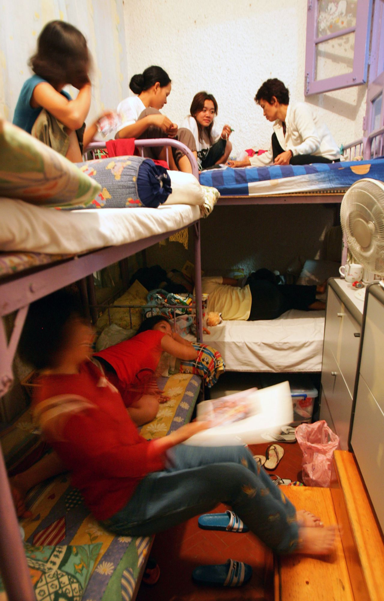 abused foreign domestic helpers rest at their bedroom in bethune house which provides temporary shelter