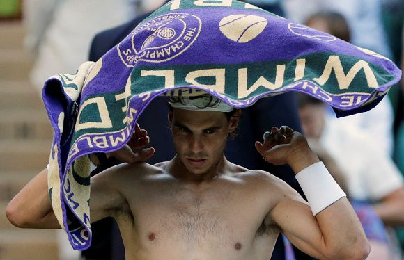 Caption: Rafael Nadal of Spain dries himself off after he lost the third set to Lukas Rosol of the Czech Republic during a second round men's singles match at the All England Lawn Tennis Championships at Wimbledon, England, Thursday, June 28, 2012. (AP Photo/Anja Niedringhaus)