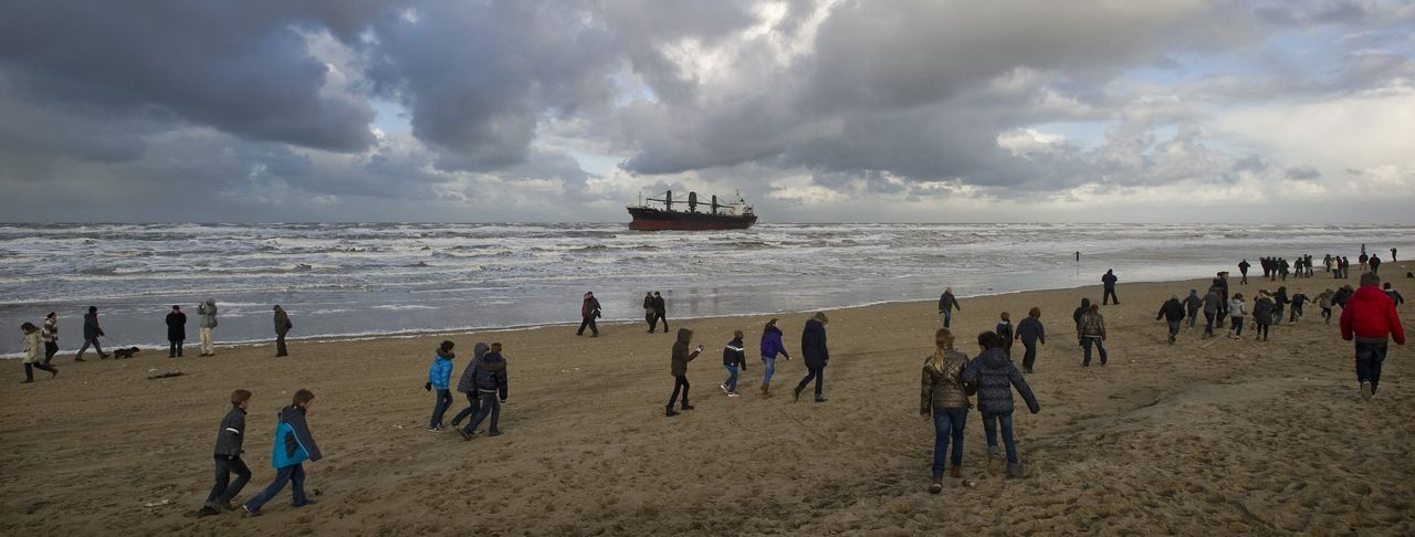 The Aztec Maiden, a Philippine-registered freighter, is seen off a Dutch beach in Wijk aan Zee January 20, 2012. The Philippine cargo ship ran aground off the Dutch coast on Friday after an unsuccessful attempt to anchor, the Dutch coastguard said. REUTERS/Robin van Lonkhuijsen/United Photos (NETHERLANDS - Tags: MARITIME)
