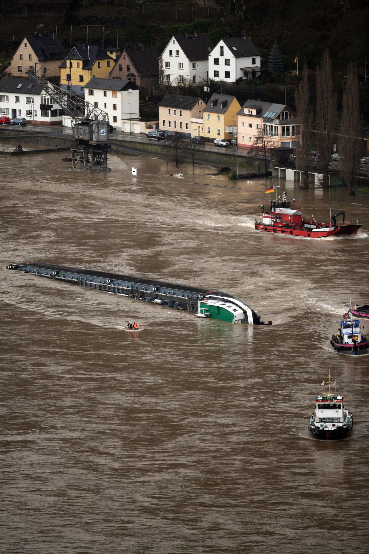 A ship loaded with 2400 tons of sulfuric acid has capsized on the Rhine river near St. Goarshausen, western Germany January 13, 2011. Traffic on the river, a major European shipping artery, was suspended following the accident and two members of the crew were rescued but two others, one German one Czech, are missing according to a water police spokesman. The ship, the Waldhof, measures roughly 110 metres (360 feet) long and was completely turned over, with its keel above the waterline, but it was not immediately clear whether acid had leaked into the river AFP PHOTO / THOMAS FREY GERMANY OUT
