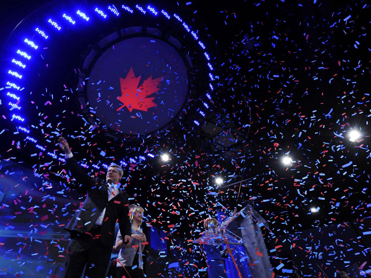 Conservative Party leader and Canadian Prime Minister Stephen Harper waves to supporters following his victory speech at his federal election night headquarters in Calgary, Alberta, May 2, 2011. With Harper are his son Ben and doughter Rachel. REUTERS/Todd Korol (CANADA - Tags: POLITICS ELECTIONS IMAGES OF THE DAY)