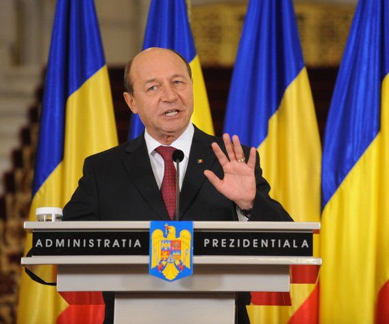 (FILES) A file picture taken on February 6, 2012 shows Romanian President Traian Basescu delivering a speech at the Cotroceni palace in Bucharest. Romania's Constitutional Court ruled on August 21 that a referendum to impeach the country's president was invalid, leaving Basescu in power. Romania's ruling center-left coalition USL headed by Prime Minister Victor Ponta last month launched a move to impeach center-right rival Basescu, which led to a referendum that failed as voter turnout fell short of the required 50 percent threshold. AFP PHOTO / ANDREI PUNGOVSCHI