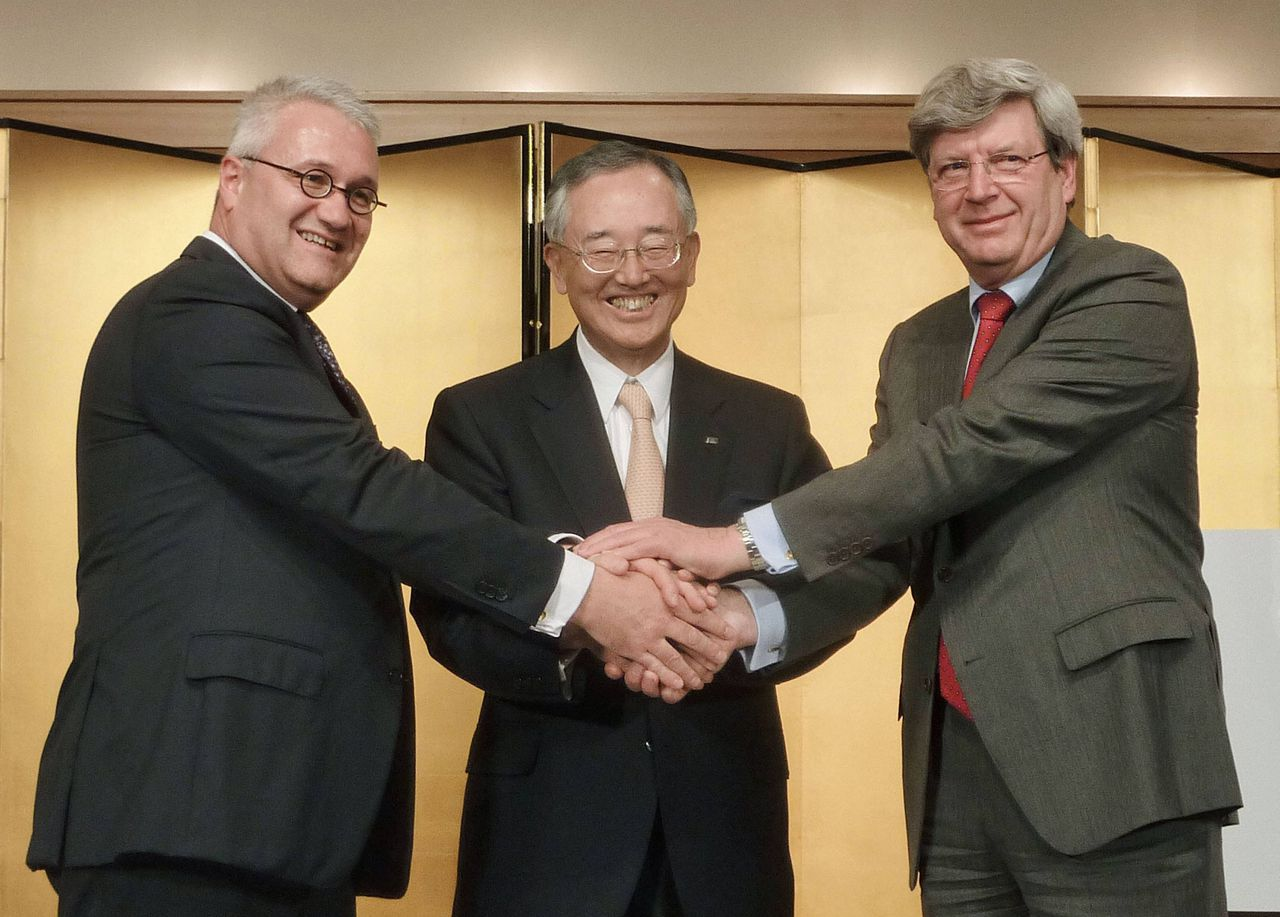 Orix Corp Chairman and Chief Executive Yoshihiko Miyauchi (C) shakes hands with Robeco Chief Executive Roderick Munsters (L) and Rabobank Chairman Piet Moerland during a news conference in Tokyo, in this photo taken by Kyodo February 19, 2013. Japanese financial services firm Orix Corp said on Tuesday it has agreed to buy Dutch asset manager Robeco from its owner, Rabobank, for 1.935 billion euros ($2.58 billion) in a cash-and-stock deal. The acquisition is the biggest ever by Orix, a diversified financial services company with businesses ranging from leasing, life insurance, real estate and corporate lending to a professional baseball team. Mandatory Credit. REUTERS/Kyodo (JAPAN - Tags: BUSINESS) ATTENTION EDITORS - THIS IMAGE WAS PROVIDED BY A THIRD PARTY. FOR EDITORIAL USE ONLY. NOT FOR SALE FOR MARKETING OR ADVERTISING CAMPAIGNS. MANDATORY CREDIT. JAPAN OUT. NO COMMERCIAL OR EDITORIAL SALES IN JAPAN. THIS PICTURE IS DISTRIBUTED EXACTLY AS RECEIVED BY REUTERS, AS A SERVICE TO CLIENTS. YES