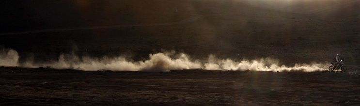 Alain Duclos of France drives his Aprilia during the seventh stage of the third South American edition of the Dakar Rally 2011 from Arica to Antofagasta January 9, 2011. REUTERS/Eric Gaillard (CHILE - Tags: SPORT MOTOR RACING IMAGES OF THE DAY)