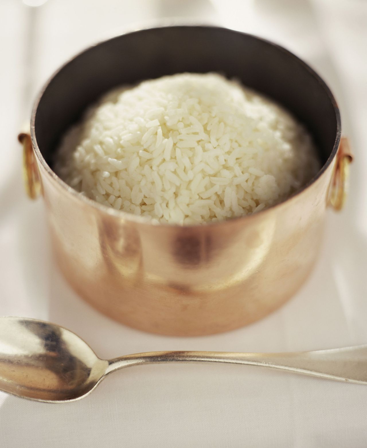 foto jupiterimages Small Copper Pot of Cooked Rice