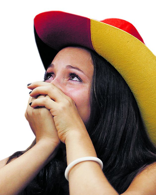 A German fan cries after the Euro 2012 soccer championship semifinal match between Germany and Italy in Warsaw, Poland, Thursday, June 28, 2012. Germany lost 1-2. (AP Photo/Frank Augstein)