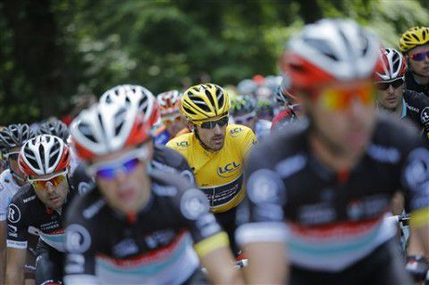 Fabian Cancellara of Switzerland, wearing the overall leader's yellow jersey, rides in the pack during the first stage of the Tour de France cycling race over 198 kilometers (123 miles) with start in Liege and finish in Seraing, Belgium, Sunday July 1, 2012. (AP Photo/Laurent Cipriani)