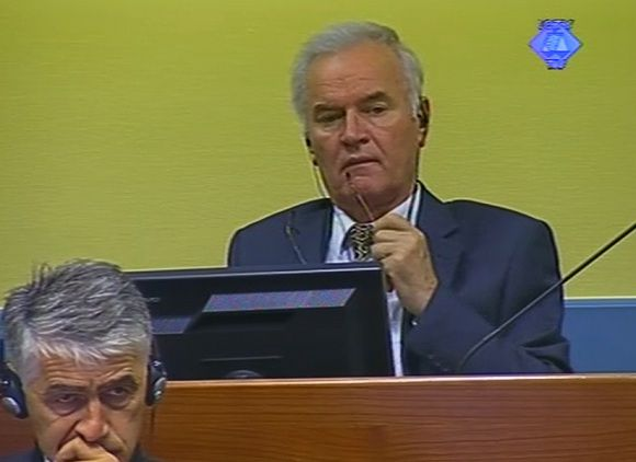 838e3dc13140f6a706700784e.jpg Caption: This video image made available by The International Criminal Tribunal for the former Yugoslavia, ICTY, shows former Bosnian Serb military chief Ratko Mladic in the court room in The Hague, Netherlands Monday July 9, 2012. Mladic faces 11 charges of genocide, war crimes and crimes against humanity. He denies wrongdoing. (AP Photo/ICTY VIDEO)