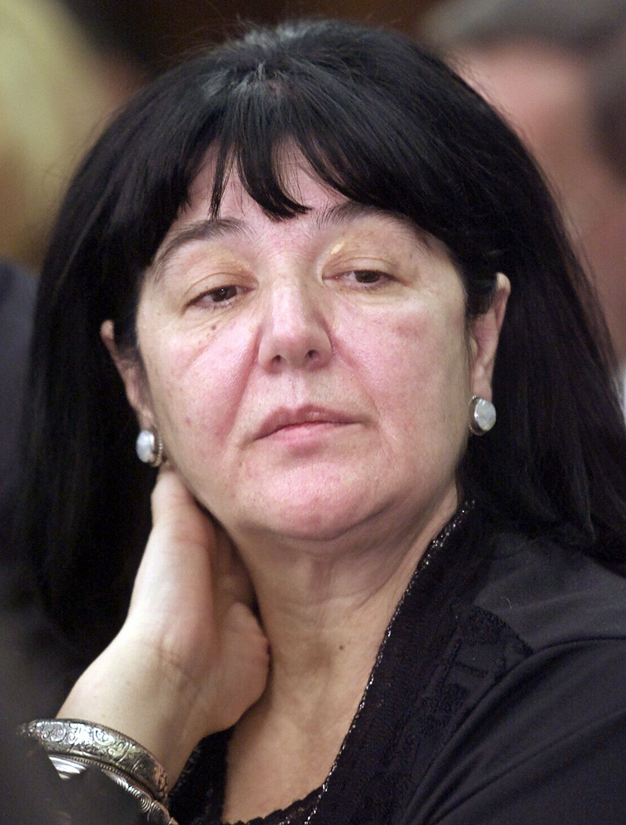 Mira Markovic Foto Reuters Mira Markovic, the widow of former Serb leader Slobodan Milosevic, attends the federal parliament session in Belgrade in this November 28, 2000 file photo. A Serb court dropped on March 14, 2006, an arrest warrant for the widow of Slobodan Milosevic, an official of Milosevic's party said, in a move that could allow her to attend his funeral if he is buried in Serbia. REUTERS/Ivan Milutinovic/Files