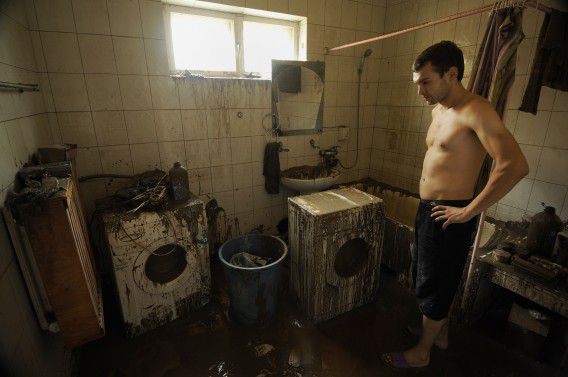 A local man inspects his flooded house in the southern Russian town of Krymsk on July 8, 2012. Russia on Sunday was reeling from devastating flash floods in its southern Krasnodar region where at least 150 people were killed and 29,000 remained without power in the region's worst natural disaster in history. AFP PHOTO / MIKHAIL MORDASOV