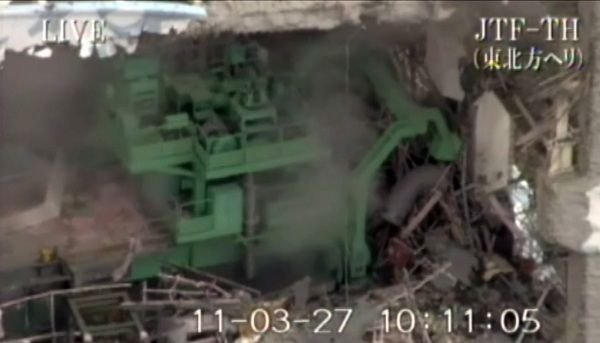 """----EDITORS NOTE---- RESTRICTED TO EDITORIAL USE - MANDATORY CREDIT """"AFP PHOTO / HO / JAPAN'S GROUND SELF-DEFENSE FORCES"""" NO MARKETING NO ADVERTISING CAMPAIGNS DISTRIBUTED AS A SERVICE TO CLIENTS This image from video taken by Japan's Ground Self-Defense Forces on March 27, 2011 shows the destroyed reactor no. 4 building at the Tokyo Electric Power Co (TEPCO) Fukushima No.1 (Dai-Ichi) nuclear power plant in the town of Okuma, in Futaba district in Fukushima prefecture. Dangerous levels of radiation detected in water thought to be leaking from the stricken Japanese reactor no. 2 dealt a new setback on March 27 to efforts to avert a nuclear disaster. AFP PHOTO / HO / JAPAN'S GROUND SELF-DEFENSE FORCES"""