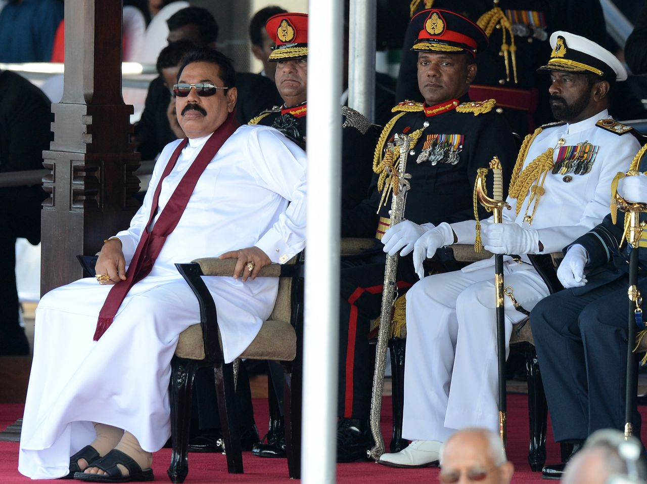 De Sri-Lankese president Mahinda Rajapakse (links) in 2014.
