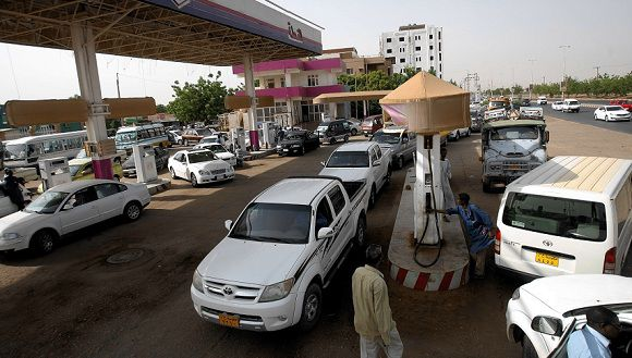Caption: Sudanese queue in a petrol station to fuel their vehicles in the capital Khartoum on June 21, 2012. Sudan announced details of planned austerity measures contained in a new budget that are expected to save the government $1.5 billion in the face of ailing finances as economy is reeling, hit by soaring inflation and a rapidly depreciating currency, with the cash-scrapped government scrambling to make up for the heavy loss of oil revenues after the secession of the South last year. AFP PHOTO/ASHRAF SHAZLY