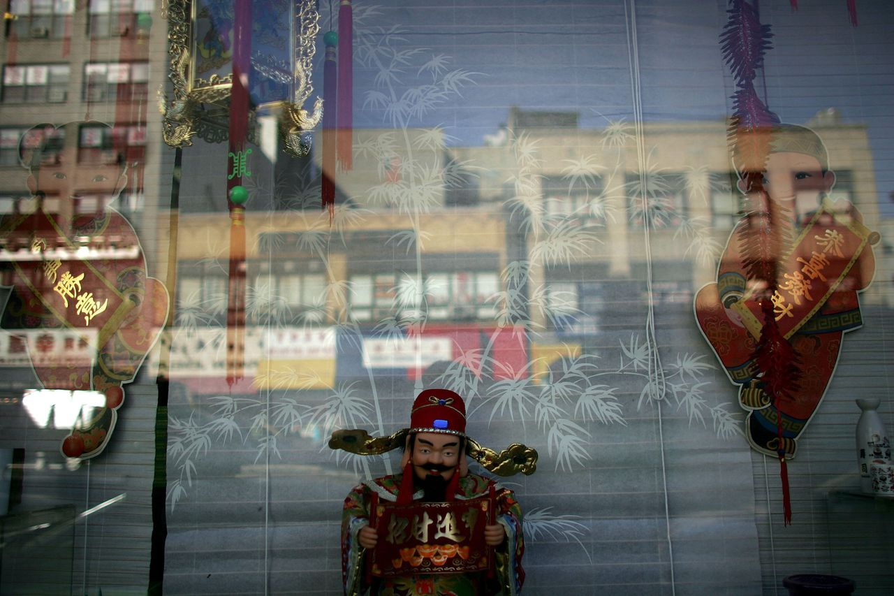 Chinese New Year decorations are displayed in a window 27 January 2006 in New York City. Chinatown continues to feel the economic effects from the 11 September 2001 terrorist attacks as critics claim that billions in federal aid have gone to other more affluent areas of Lower Manhattan. Hundreds of small garment factories have closed since 9/11, throwing thousands out of work. Disrupted traffic patterns, primarily from the closure of Park Row since the attacks, has wreaked economic havoc on businesses trying to get goods in and out of the district. Spencer Platt/Getty Images/AFP == FOR NEWSPAPER & TV USE ONLY ==