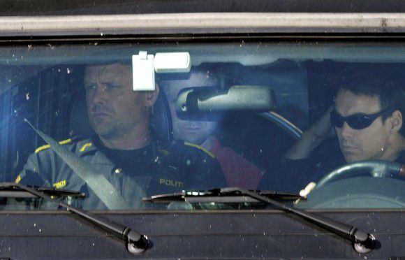 Anders Behring Berivik is seen partly obscured in the back seat as he arrives in an armoured police vehicle for questioning at the Police HQ in Oslo on July 29, 2011. Breivik has confessed to the attack on government buildings and massacre on the youth camp of the Norwegian Labour Party. At least 76 were killed in last Friday's attacks in Norway, a bombing in central Oslo and a series of shootings on an island just outside the capital, and the figure could rise, a senior police officer said. Police had also found explosives on the island of Utoeya, where a gunman opened fire on young people at a summer camp organised by the ruling Labour Party, Sveinung Sponheim, acting commissioner for Oslo police, told reporters. AFP PHOTO / ODD ANDERSEN