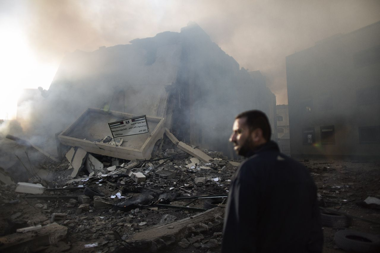 TOPSHOTS A Palestinian man looks at rubble of the Civilian Affairs branch of the Ministry of Interior following an Israeli air raid in Gaza City on November 16, 2012. Israel was condemned by much of the Arab world while securing Western backing and pressing its biggest air assault on Gaza for years amid a wave of Palestinian short-range rocket fire. AFP PHOTO/MARCO LONGARI