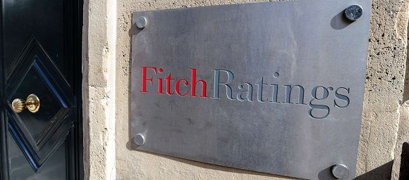 """Caption: A picture shows the entrance of Fitch ratings agency on August 8, 2011 in Paris. The Fitch ratings agency confirmed on August 10, 2010, that France was retaining its top triple-A credit rating amid rumours that it would lose the prized status. France earlier in the day """"categorically"""" denied rumours it was heading for a downgrade of its AAA credit rating after the United States was stripped of its top rating by Standard & Poor's last week."""