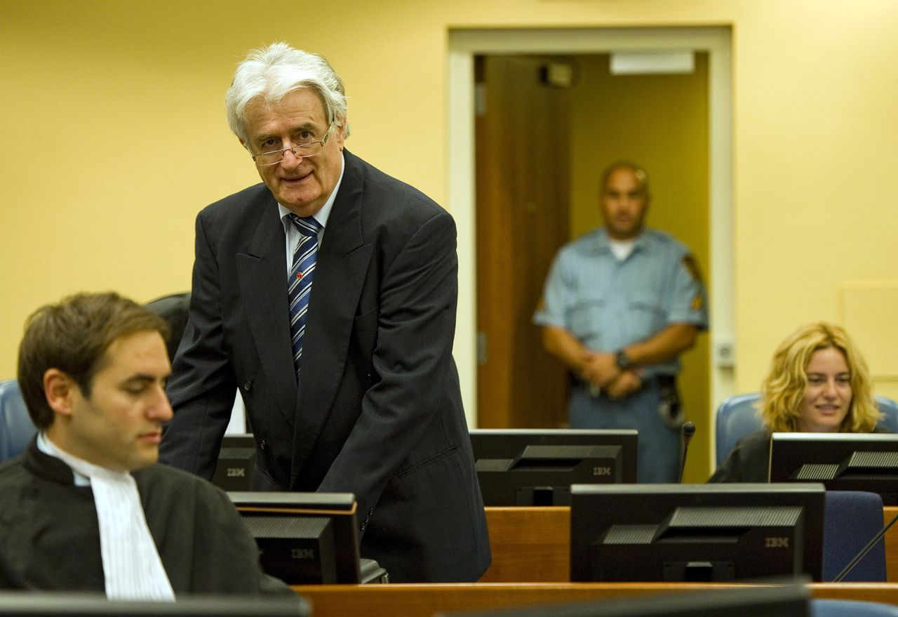 Former Bosnian Serb leader Radovan Karadzic enters the courtroom on the first day of his defense against war crime charges at the International Criminal Tribunal for the Former Yugoslavia in The Hague, Netherlands on October 16, 2012. The Yugoslavia war crimes tribunal begins trying its last suspect on Tuesday. A strident Radovan Karadzic told the UN Yugoslav war crimes court Tuesday that nobody thought there would be genocide in Bosnia and that he should be rewarded for doing all to avoid war. AFP PHOTO / POOL - Robin van Lonkhuijsen