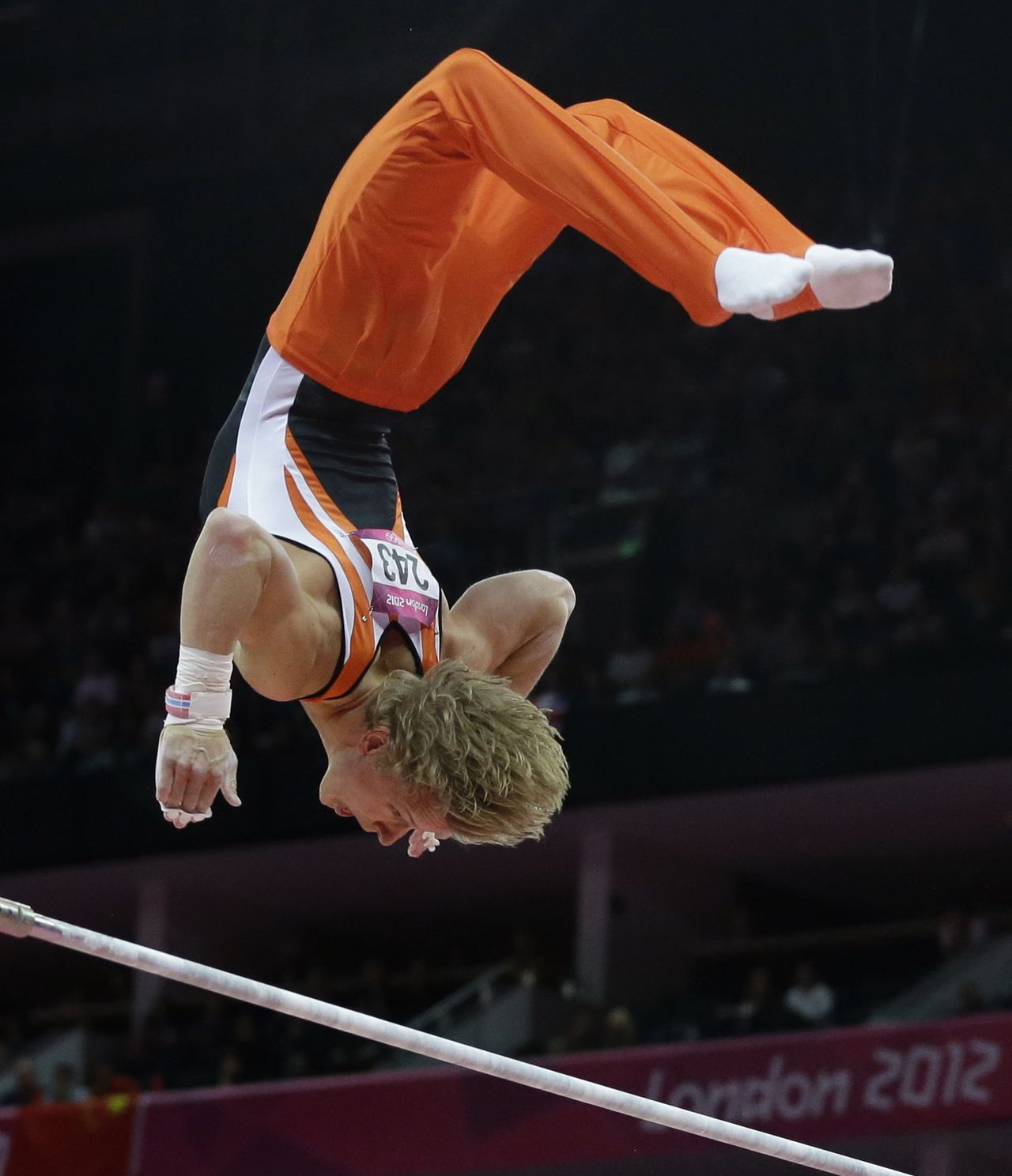 Gymnast from the Netherlands Epke Zonderland performs on the horizontal bar during the artistic gymnastics men's apparatus finals at the 2012 Summer Olympics, Tuesday, Aug. 7, 2012, in London. (AP Photo/Julie Jacobson)