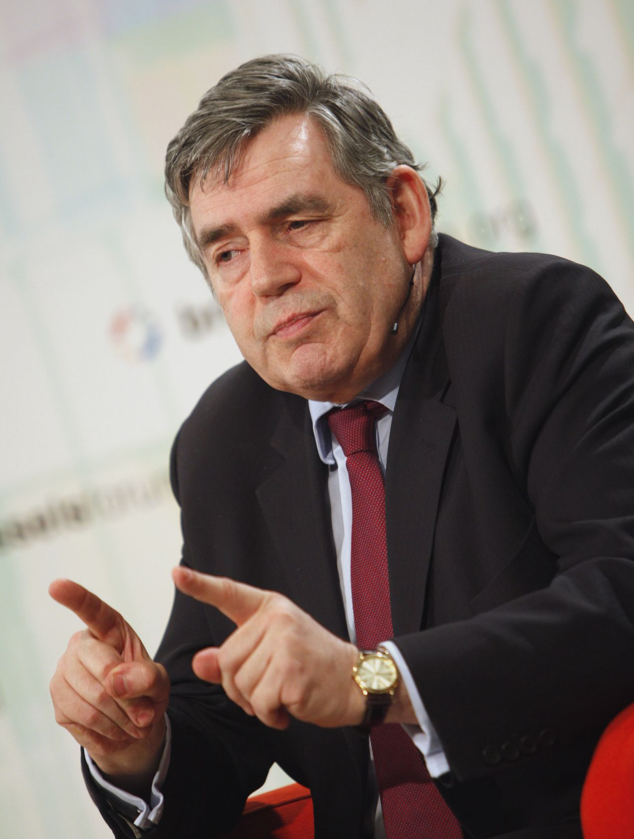 "Former British Prime Minister Gordon Brown speaks during a session 'Keeping the G20 en Vogue' at a German Marshall Fund event in Brussels on Saturday, March 26, 2011. Less than a week ahead of a meeting of the Group of 20 in China, former British Prime Minister Gordon Brown urged the world's most powerful economies to seal a ""global growth pact"" to fight unemployment. (AP Photo/Virginia Mayo)"