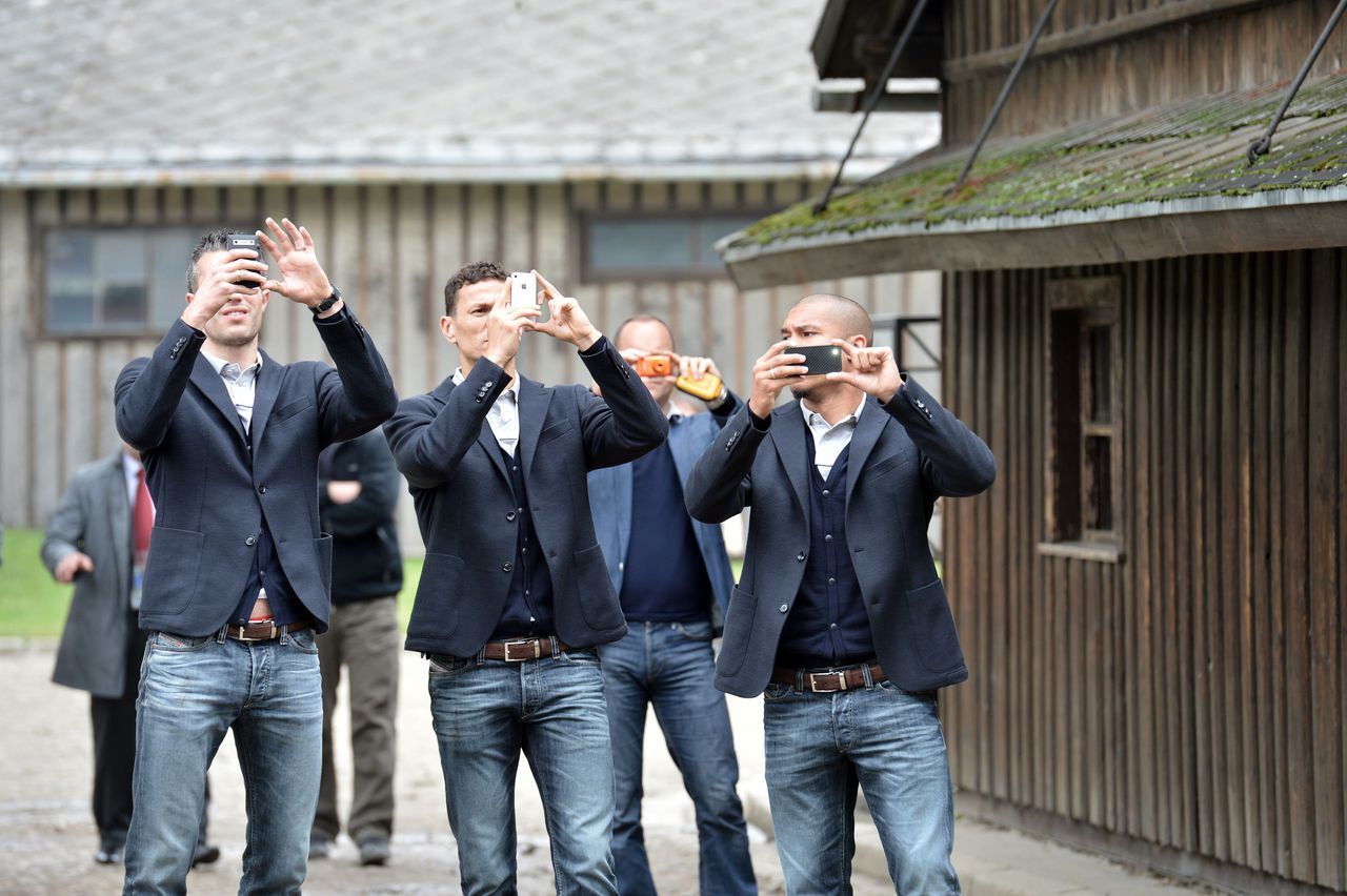 Dutch national football team forward Robin Van Persie (L) and teammates take pictures as they visit the former Nazi German death camp at Auschwitz-Birkenau on June 6, 2012. AFP PHOTO / GIUSEPPE CACACE