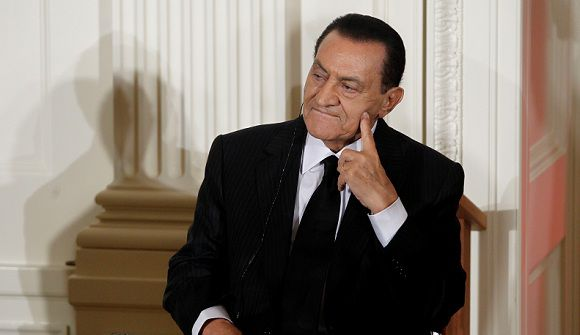 Caption: FILE - In this Wednesday, Sept. 1, 2010 file photo, Egypt's then President Hosni Mubarak listens as Israel's Prime Minister Benjamin Nethanyahu, unseen, speaks in the East Room of the White House in Washington. A statement by the Egyptian prosecutor general released on Egypt's state news agency says that Hosni Mubarak and his sons will face trial on charges related to the deadly shootings of protesters during the uprising that led to the Egyptian leader's ouster. (AP Photo/Charles Dharapak, File)