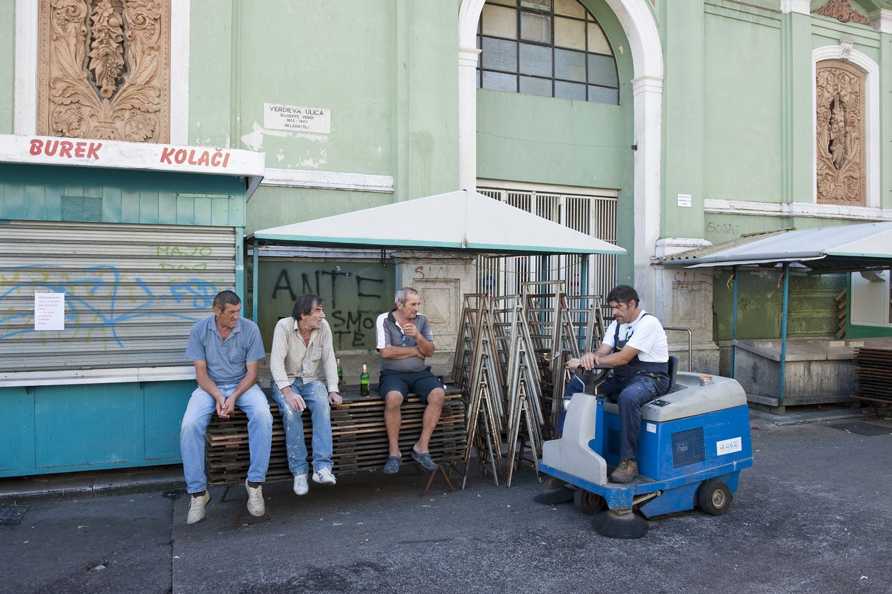Rijeka, Croatia, August 29, 2011 Drinking men in front of Rijeka fish market. ©Nick Hannes