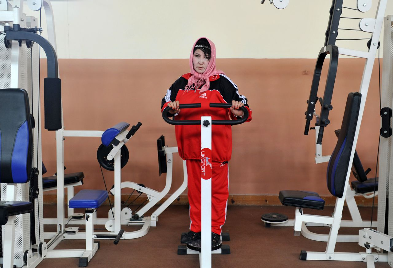 An Afghan woman exercises at a gym in Kabul on October 5, 2011. Women's rights in Afghanistan risk being forgotten as international troops withdraw and the government struggles for a peace deal 10 years after the Taliban were ousted, two charities said. Separate reports by Oxfam and ActionAid say women's rights have improved since the October 2001 US-led invasion, particularly access to education with 2.7 million girls now in school, according to Oxfam. AFP PHOTO / ADEK BERRY