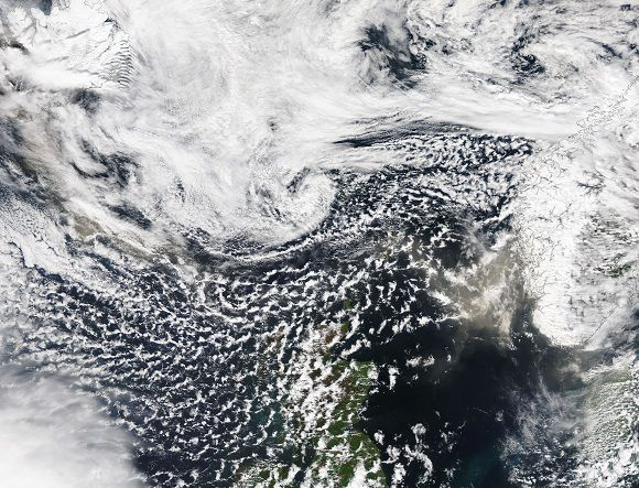 This satellite image released by NASA shows a tan volcanic ash plume over the North Sea caused by the Grimsvotn volcano in Iceland, at 13:05 GMT, Tuesday, May 24, 2011. The volcano began erupting on Saturday, sending clouds of ash high into the air. The amount of ash spewing from the volcano tapered off dramatically on Tuesday, however, said Elin Jonasdottir, a forecaster at Iceland's meteorological office. (AP Photo/NASA)