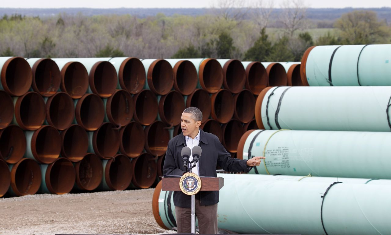 """FILE - In this Thursday, March 22, 2012 file photo, President Barack Obama speaks at the TransCanada Pipe Yard in Cushing, Okla. The president says that the proposed Keystone XL pipeline project from Canada to Texas should only be approved if it doesn't worsen carbon pollution. Obama says allowing the oil pipeline to be built requires a finding that doing so is in the nation's interest. He says that means determining that the pipeline does not contribute and """"significantly exacerbate"""" emissions. (AP Photo/LM Otero, File)"""