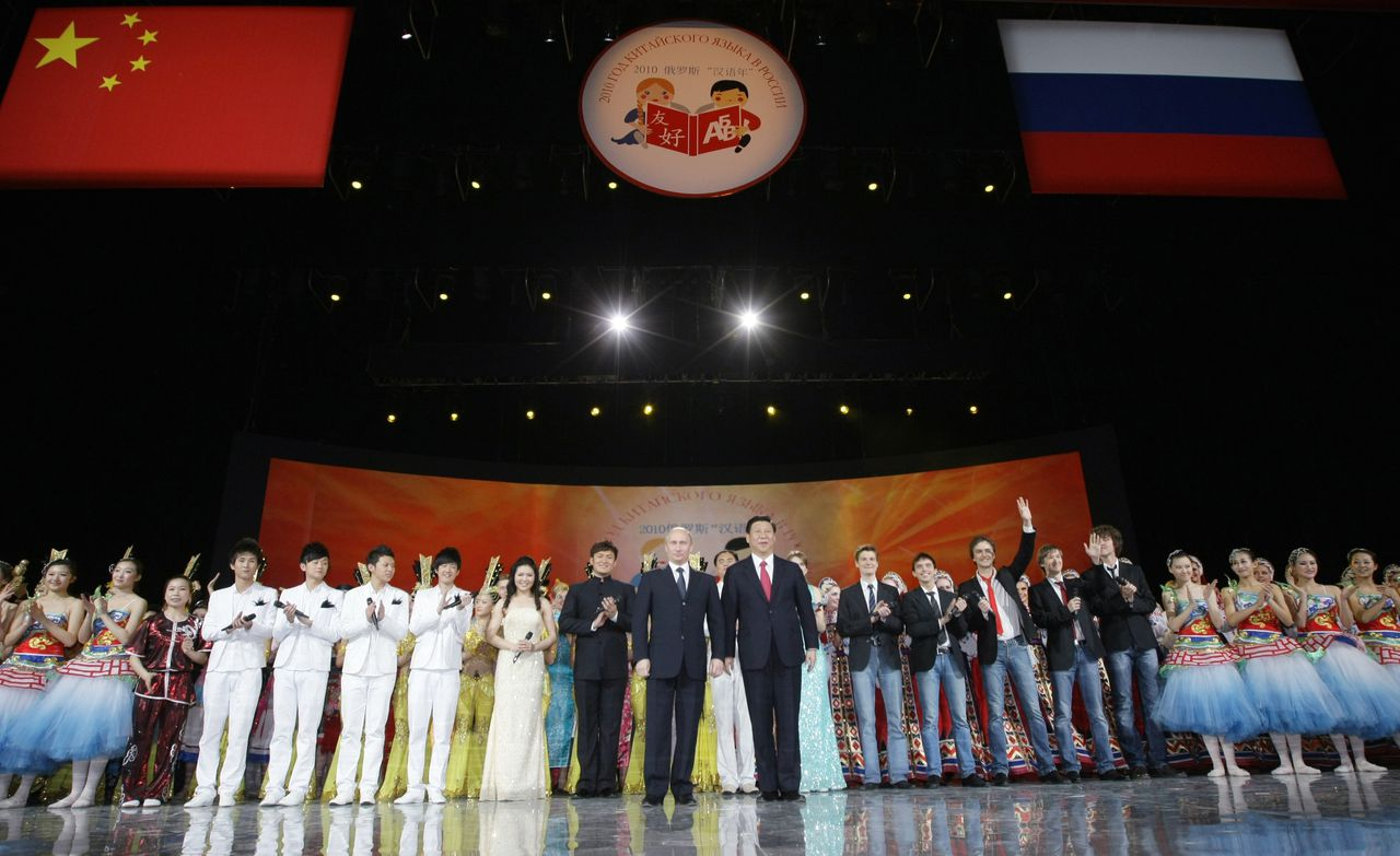 March 23, 2010. From left to right, foreground: Russian Prime Minister Vladimir Putin and Chinese Vice President Xi Jinping at the opening ceremony for the Year of the Chinese Language in Russia, that was held in the State Kremlin Palace.