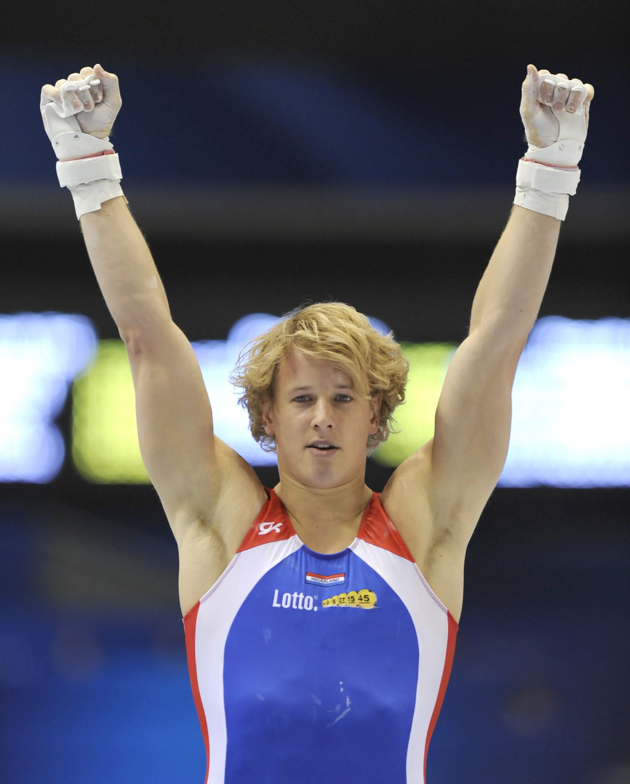 Epke Zonderland of the Netherlands reacts after his performance with the horizontal bar during men's qualification at the world gymnastics championships in Tokyo on October 9, 2011. The top eight men's teams will advance to the finals and earn berths in next year's London Olympics. AFP PHOTO/KAZUHIRO NOGI