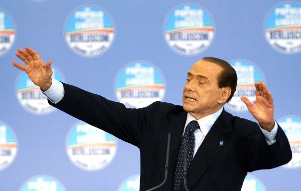 Italy's Prime Minister Silvio Berlusconi gestures during a party meeting to support Gianni Lettieri, Naple's mayoral candidate, in Naples May 13, 2011. Italians vote in local elections on Sunday and Monday, a test of how badly Berlusconi has been hurt by sex scandal, three trials for corruption and a stagnating economy. REUTERS/Ciro De Luca (ITALY - Tags: POLITICS)