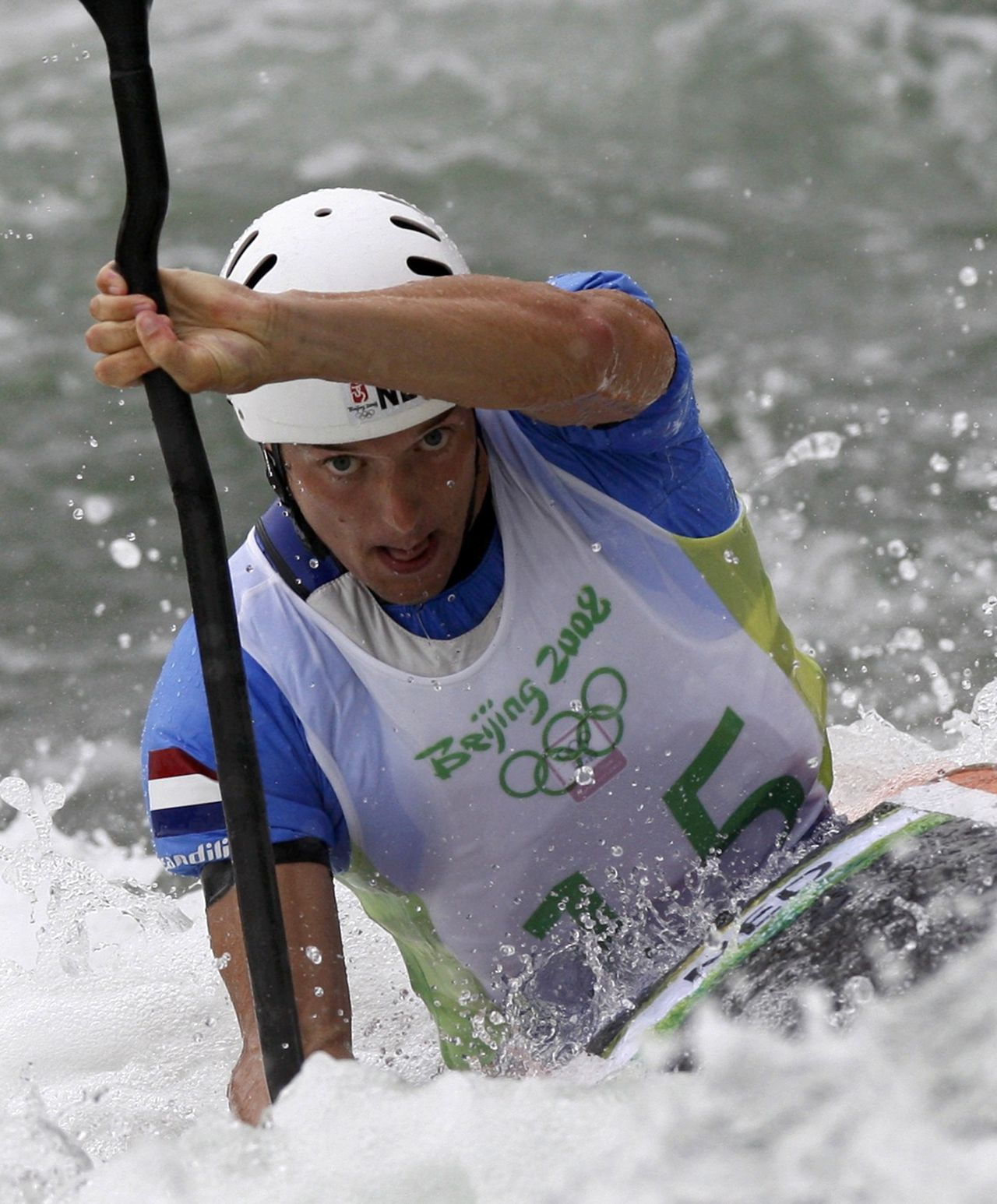 Robert Bouten of the Netherlands paddles during the first run of his men's kayak (K1) heats at the Beijing 2008 Olympic Games August 11, 2008. REUTERS/Darren Whiteside (CHINA)