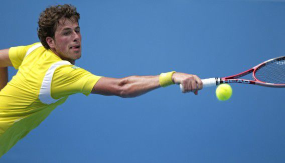 during their first round match at the Australian Open tennis championship, in Melbourne, Australia, Tuesday, Jan. 17, 2012. (AP Photo/Rick Rycroft)