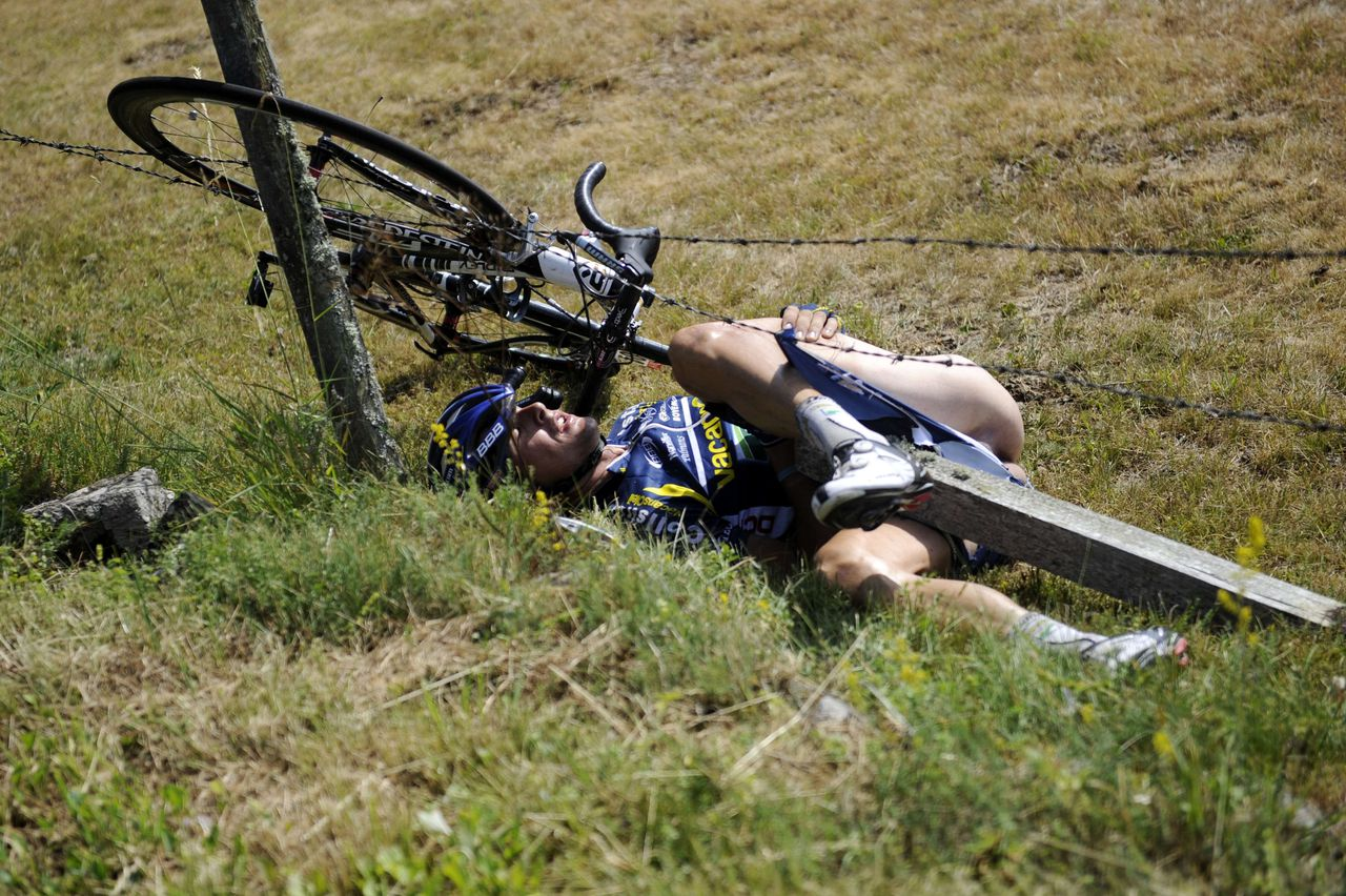 One of the breakaway men, Netherland's Johnny Hoogerland, is seen after he crashed and landed in a fence at the side of the road during the 208 km and ninth stage of the 2011 Tour de France cycling race run between Issoire and Saint-Flour, center rance, on July 10, 2011. Spain's Juan Antonio Flecha and Hoogerland survived being hit at speed by a car which bore the marking of France Televisions. AFP PHOTO / LIONEL BONAVENTURE