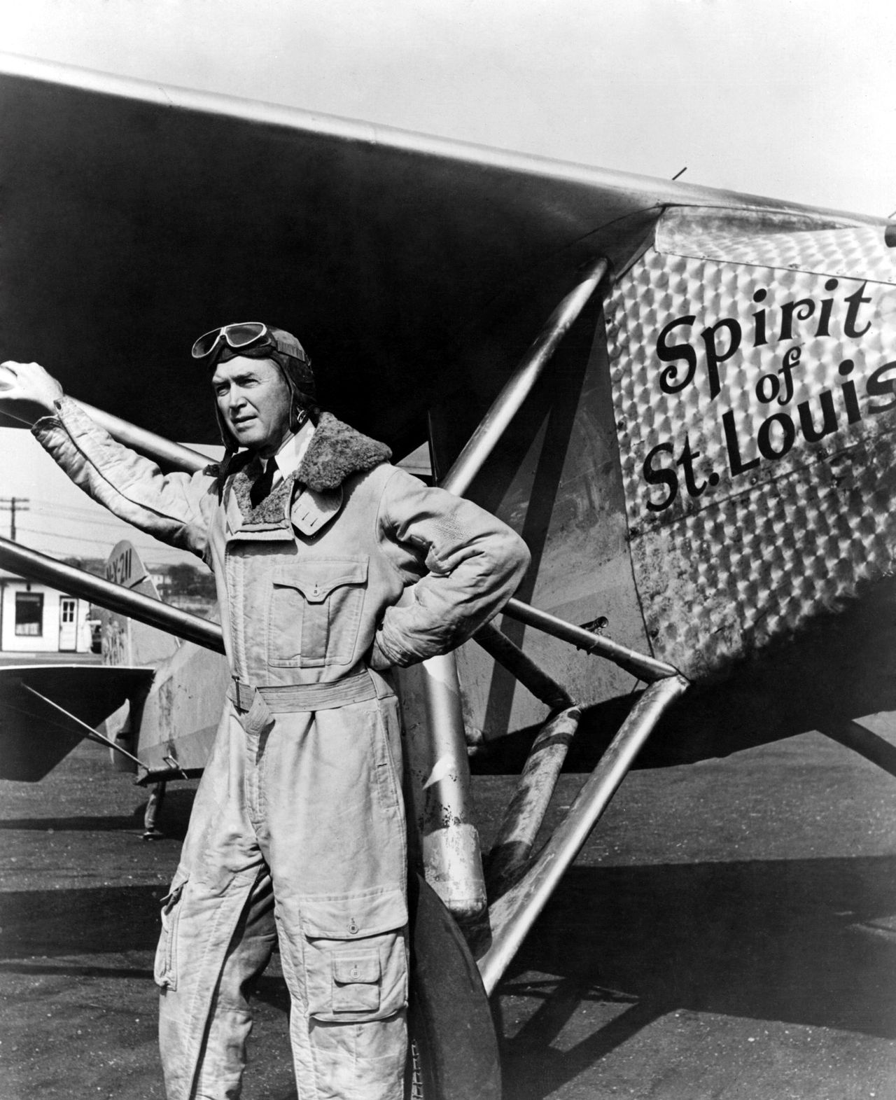 Actor James Stewart (1908 - 1997) as pilot Charles Lindbergh in front of his plane 'Spirit of St Louis,' a modified version of a Ryan monoplane mail-carrier, in the film 'Spirit Of St Louis', (filmed in USA)1957. The film was directed by Billy Wilder for Warner. (Photo by Hulton Archive/Getty Images)
