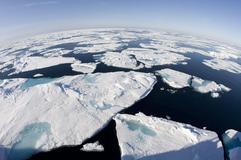 In this July 10, 2008 photo, ice floes float in Baffin Bay above the arctic circle seen from the Canadian Coast Guard icebreaker Louis S. St-Laurent. Climate change will be costing Canada and its people about $5 billion a year by 2020, a groundbreaking analysis for the federal government warns. (AP Photo/The Canadian Press, Jonathan Hayward)