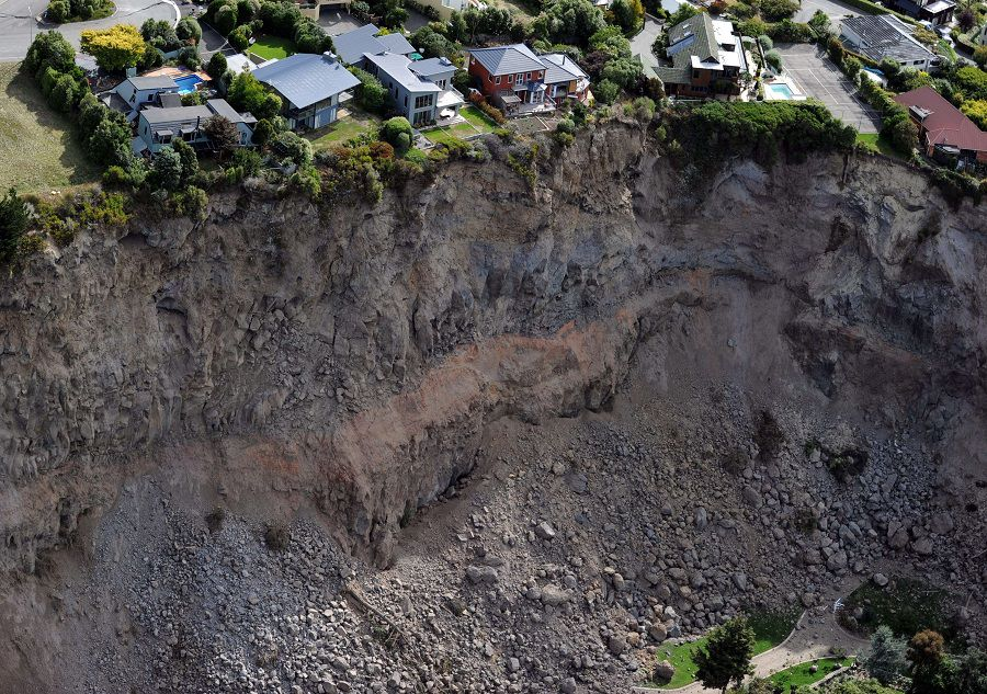 AFP PICTURES OF THE YEAR 2011 Luxury houses teeter on the edge after landslides in Redcliffs near Christchurch on February 27, 2011, after a 6.3 earthquake devastated New Zealand's second city and surrounding towns on February 22. The quake caused more damage than the 7.1 magnitude quake that hit the city on September 4, 2010 and has killed at least 146 people. AFP PHOTO / Torsten BLACKWOOD