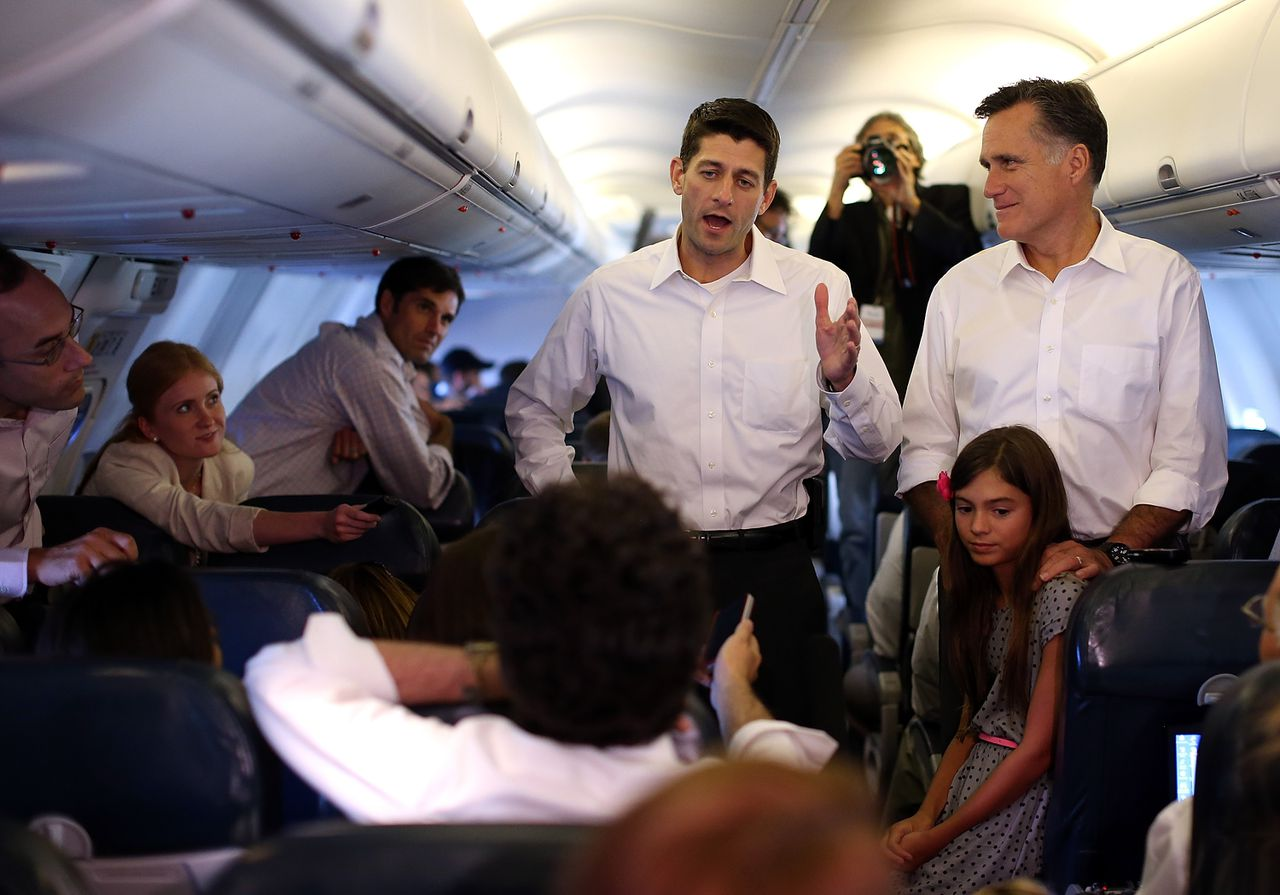 IN FLIGHT, VA - AUGUST 11: Republican presidential candidate and former Massachusetts Governor Mitt Romney (R) and his running mate Rep. Paul Ryan (R-WI) (L) speak to reporters aboard their campaign plane on August 11, 2012 en route to Charlotte, North Carolina. Mitt Romney kicked off a four day bus tour with an announcement of his running mate, Rep. Paul Ryan (R-WI). Justin Sullivan/Getty Images/AFP == FOR NEWSPAPERS, INTERNET, TELCOS & TELEVISION USE ONLY ==