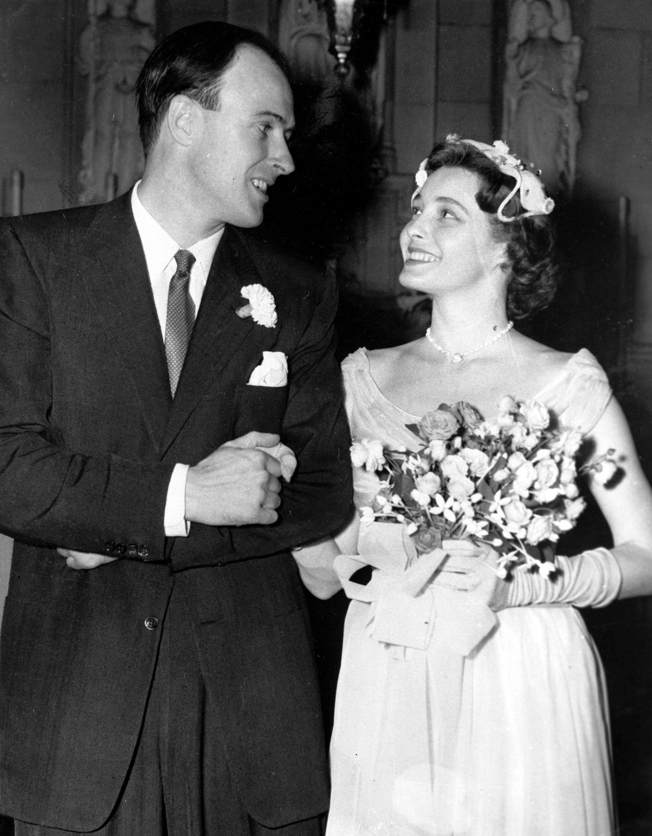 Hollywood screen star Patricia Neal smiles at her new husband British writer Roald Dahl after their wedding at Trinity Church Chapel in New York, July 2, 1953. (AP Photos)