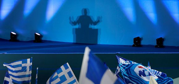 Caption: Conservative New Democracy party leader Antonis Samaras casts a shadow as he delivers his speech during a pre-election rally at Syntagma square in Athens June 15, 2012. Greece faces a stark choice between sticking with the euro or returning to the drachma in a knife-edge election this weekend, conservative leader Antonis Samaras told his final election rally on Friday. REUTERS/John Kolesidis (GREECE - Tags: POLITICS BUSINESS ELECTIONS)