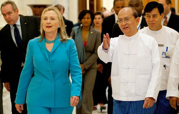 Caption: U.S. Secretary of State Hillary Clinton (2nd L) walks with Myanmar's President Thein Sein (2nd R) in between meetings at the President's Office in Naypyitaw December 1, 2011. Clinton prepared for her first substantive talks with Myanmar's new leaders on Thursday, a meeting U.S. officials hope will embolden reformers in the reclusive country where entrenched military interests still loom large. REUTERS/Saul Loeb/Pool (MYANMAR - Tags: POLITICS)