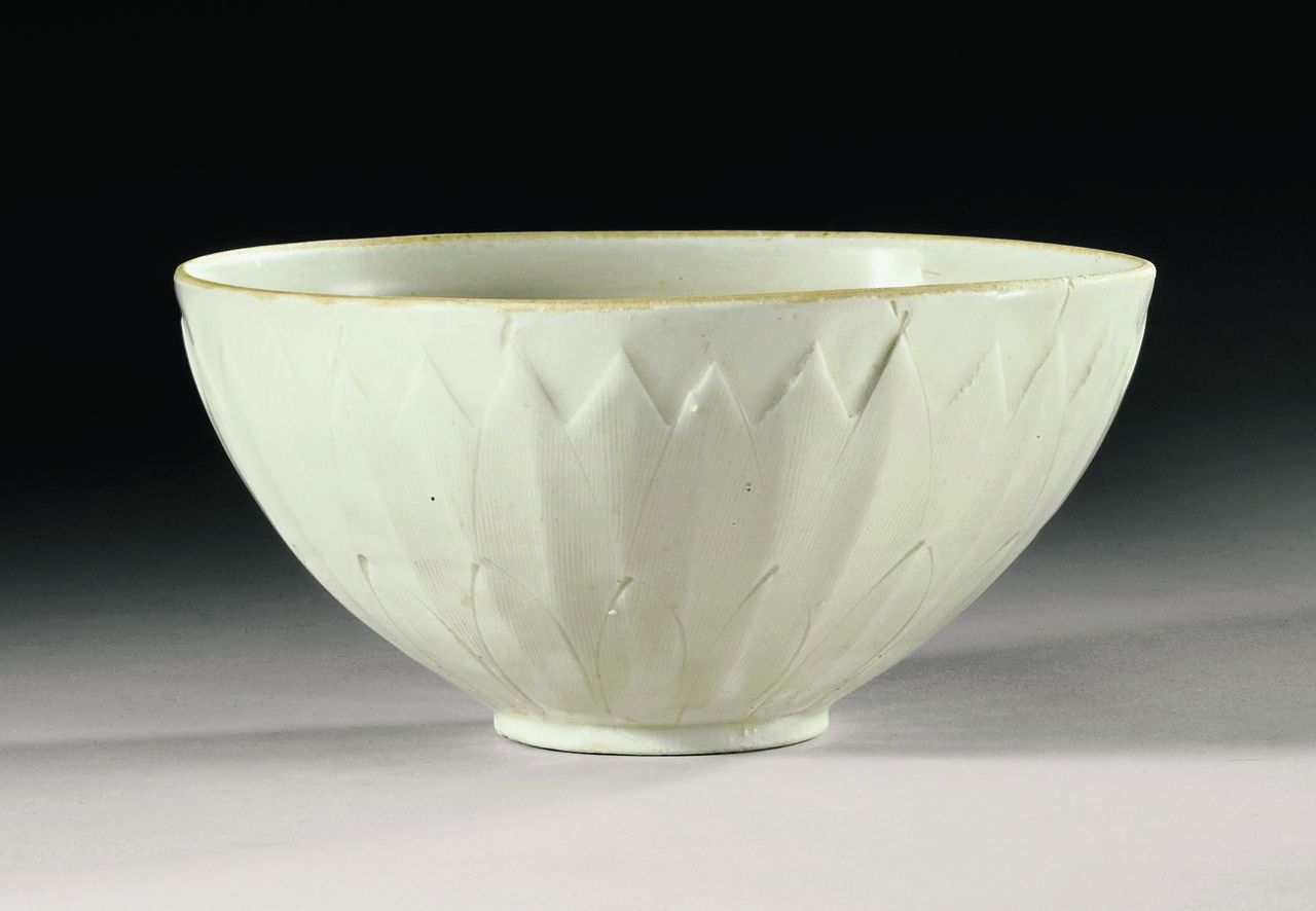 """This undated photo provided by Sotheby's Auction House in New York shows a 1,000-year-old Chinese """"Ding"""" bowl from the Northern Song Dynasty. The bowl, purchased from a tag sale for no more than three dollars, was sold by Sotheby's for more than $2.22 million during the opening session of Sotheby's fine Chinese ceramics and works of art auction Tuesday, March 19, 2013 in New York. (AP Photo/Sotheby's Auction House)"""